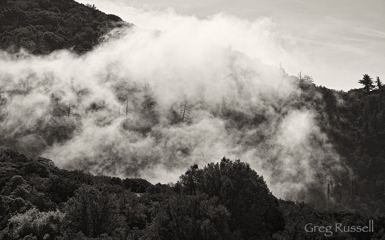Fog drifts in the valleys of the San Bernardino Mountains above Redlands