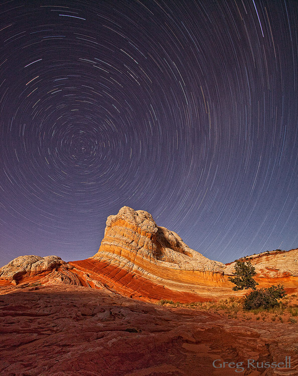 Star trails over a hoodoo at the White Pocket