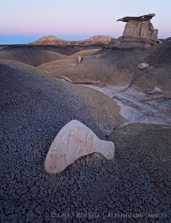 photo of bentonite badlands and whimsical rock formations in predawn light in the Bisti Badlands of northern New Mexico