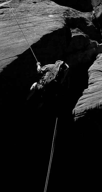 A canyoneer rappels in Zion National Park, Utah