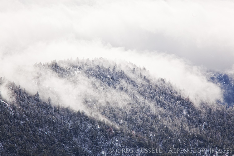 photograph of clouds on a snowy ridge top in southern california's san jacinto mountains